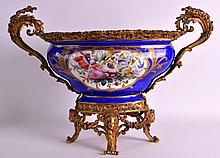 A 19TH CENTURY SEVRES PORCELAIN TWIN HANDLED JARDINIERE painted with chuerbs within a gilt shaped cartouche, mounted in ornate ormolu. 1ft 8ins x 1ft 2ins.