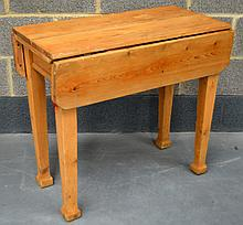 A COUNTRY PINE DROP FLAP DINING TABLE.