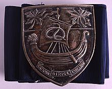 AN EARLY 20TH CENTURY SILVER PLATED NURSES BUCKLE unusually depicting a Viking boat in relief. Buckle 2.5ins wide.