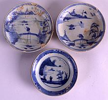 A SET OF THREE 18TH CENTURY CHINESE CA MAU CARGO CAFE AU LAIT SAUCERS painted with a figure before a lakeland landscape. 4Ins diamater. (3)