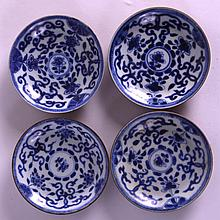 A SET OF FOUR 18TH CENTURY CHINESE CA MAU CARGO CAFE AU LAIT SAUCERS painted with floral sprays and vines. 4.25ins diameter. (4)