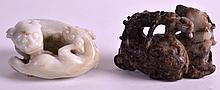 A 19TH CENTURY CHINESE BLACK MUTTON JADE CARVED GROUP OF DEER together with another carved hardstone group of hounds. 2.5ins & 2.25ins wide. (2)