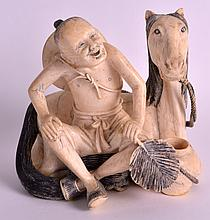 AN EARLY 20TH CENTURY CHINESE CARVED IVORY FIGURE OF A MALE modelled seated upon a recumbant horse, holding a fan. 5Ins x 4.5ins.