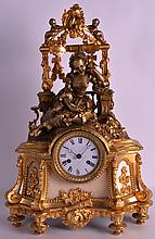 AN EARLY 20TH CENTURY FRENCH ORMOLU MANTEL CLOCK modelled as a reclining young female resting, overlaid with flowers. 1Ft 7ins high.