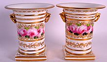 A PAIR OF EARLY 19TH CENTURY BILLINGSLEY STYLE ROSES probably Worcester, painted with central roses. 4.75ins high.