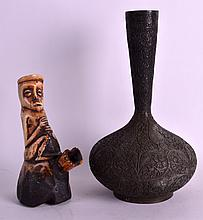 AN EARLY 20TH CENTURY AFRICAN CARVED BONE PIPE together with an embossed indian bronze vase. 8.5ins & 11.5ins high. (2)