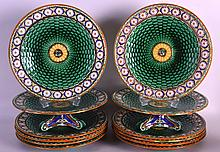 A SET OF TEN 19TH CENTURY WEDGWOOD MAJOLICA LATTICE MOULDED PLATES together with two matching tazzas. 8.5ins diameter. (12)