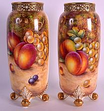 A FINE PAIR OF MID 20TH CENTURY ROYAL WORCESTER RETICULATED NECK VASES painted with fruit by John Freeman. 9.25ins high.