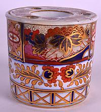 AN EARLY 19TH CENTURY COALPORT DRUM SHAPED INKWELL painted with an imari style pattern. 2.75ins high.