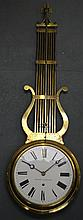 A LOVELY FRENCH GILT LYRE DISPLAY CLOCK 'HORLOGER CONSTRUCTEUR with large white enamel dial and black painted numerals. 4Ft long.