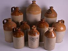 A SET OF TEN 19TH CENTURY AND LATER STONEWARE BARRELS including those of local interest. Largest 1ft 6ins high. (10)