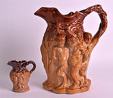 A 19TH CENTURY ENGLISH STONEWARE JUG decorated with classical figures in relief, together with a matching smaller jug. 8.5ins & 3.75ins high. (2)