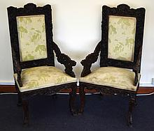 A LARGE PAIR OF 19TH CENTURY CHINESE CARVED HARDWOOD DRAGON THRONES with floral decoration