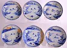 A SET OF SIX 18TH CENTURY CHINESE BLUE AND WHITE CA MAU CARGO SAUCERS painted with two boats and a fisherman within a landscape, all with coral encrustations. 4.5ins diameter. (6)