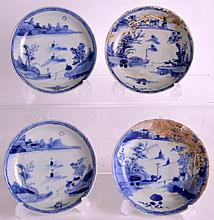A MATCHED SET OF FOUR 18TH CENTURY CHINESE BLUE AND WHITE CA MAU CARGO SAUCERS painted with boats within landscapes, some with coral encrustation. 4.25ins diameter. (4)