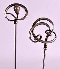 A LARGE PAIR OF ART NOUVEAU SILVER HAT PINS by Cha