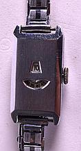 AN UNUSUAL 1950S GENTLEMANS STEEL WRISTWATCH with
