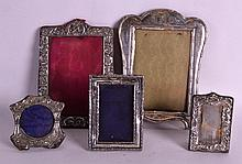 A GROUP OF FIVE SILVER PHOTOGRAPH FRAMES including