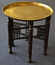 AN EARLY 20TH CENTURY EASTERN BRASS TRAY TOP TABLE