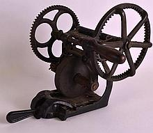 A 19TH CENTURY AMERICAN HARVESTER AND CO CAST IRON