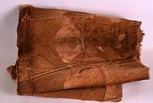 AN EARLY 20TH CENTURY ANTELOPE SKIN BED COVER of n