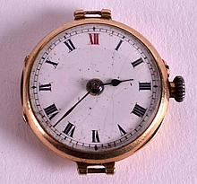 A 1920S 9CT YELLOW GOLD WRISTWATCH FACE. 1.5ins di
