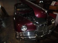 Antique Sale with Original artwork and featuring a 1949 Packard Car! A must-see auction for any true collector!