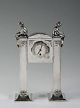 MORITZ HACKER (1849-1932) SILVER PLATED TABLE CLOCK