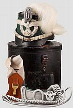 A shako for officers of Schutzpolizei with parade plume, helmet case and accessories
