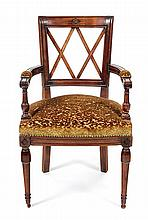 A French Provincial Style Carved Walnut Armchair Height 34 1/4 x width 20 1/2 x depth 16 inches.