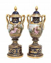 A Pair of Lidded Porcelain Urns Height 12 1/2 inches.