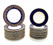 Sixteen Royal Doulton Porcelain Dinner Plates Diameter of largest 10 1/4 inches.
