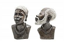 A Pair of Stone Carved African Style Busts Height of taller 10 1/4 inches.