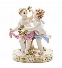 A Meissen Porcelain Figural Group Height 4 3/4 inches.