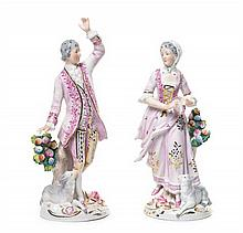A Pair of Continental Porcelain Figures Height 8 1/2 inches.