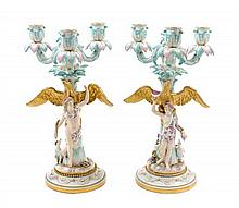 A Pair of Meissen Porcelain Three-Light Figural Candelabra Height 13 1/2 inches.