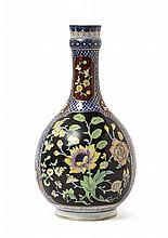 A Chinese Famille Rose on Black Ground and Underglaze Blue Porcelain Bottle Vase YONGZHENG PERIOD Height 9 1/2 inches.