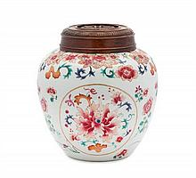 A Chinese Famille Rose Porcelain Covered Jar 18TH/19TH CENTURY Height 7 5/8 inches.