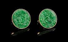 A Pair of Chinese 14 Karat Gold and Jadeite Cufflinks Diameter of jadeite 1 1/8 inches.