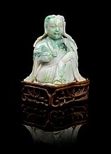 A Chinese Jadeite Figure of Guanyin LATE 19TH/EARLY 20TH CENTURY Height of jade 4 3/4 x width 4 1/2 inches.