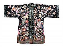 A Chinese Black Silk Robe LATE 19TH/EARLY 20TH CENTURY Length 42 inches.
