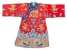 A Chinese Red Embroidered Silk Dragon Robe MID/LATE QING DYNASTY Length 39 1/4 inches.