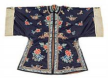 A Chinese Embroidered Silk Lady's Robe LATE QING DYNASTY Height 44 1/4 inches.