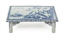 A Blue and White Porcelain Scholar's Table 19TH CENTURY OR EARLIER Height 8 x width 27 5/8 x depth 18 inches.