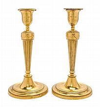 A Pair of George III Brass Candlesticks Height 10 1/2 inches.