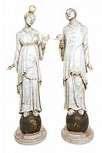 A Pair of Italian White Marble Figures Height of taller 27 1/2 inches.