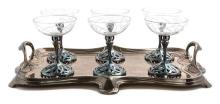 A German Art Nouveau Silver-Plate and Etched Glass Champagne Set Height 5 1/8 inches, length of waiter over handles 18 3/4 inches.