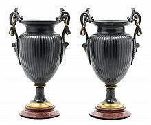 A Pair of Neoclassical Cast Metal Urns Height 13 1/4 inches.