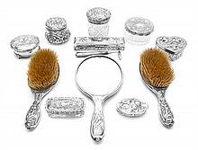 An Assembled American Art Nouveau Silver and Silver Mounted Dressing Set Length of first overall 11 inches.