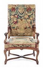 A Henry II Style Walnut Open Armchair Height 45 inches.